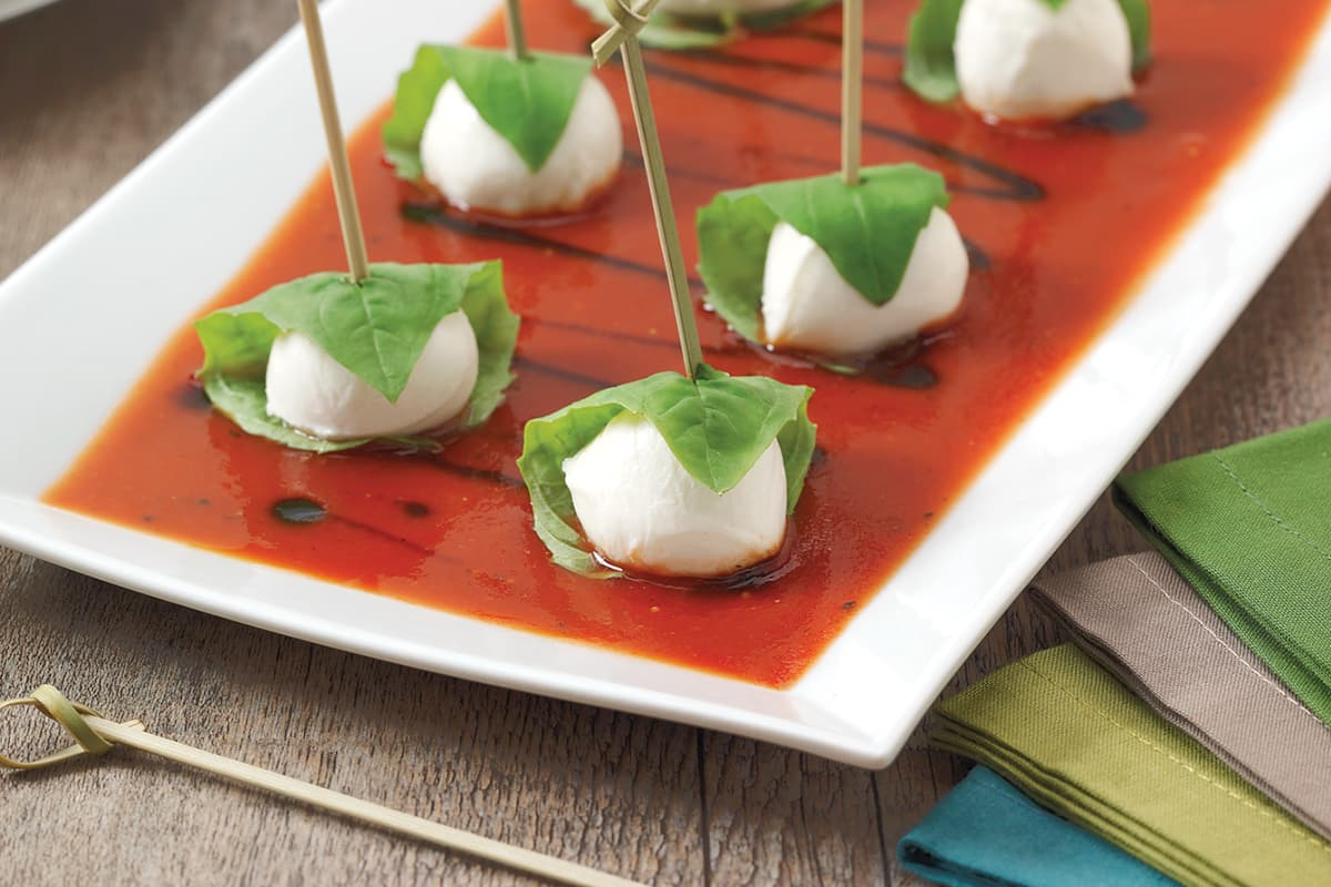 Caprese Bites with Cracked Pepper Balsamic Sauce