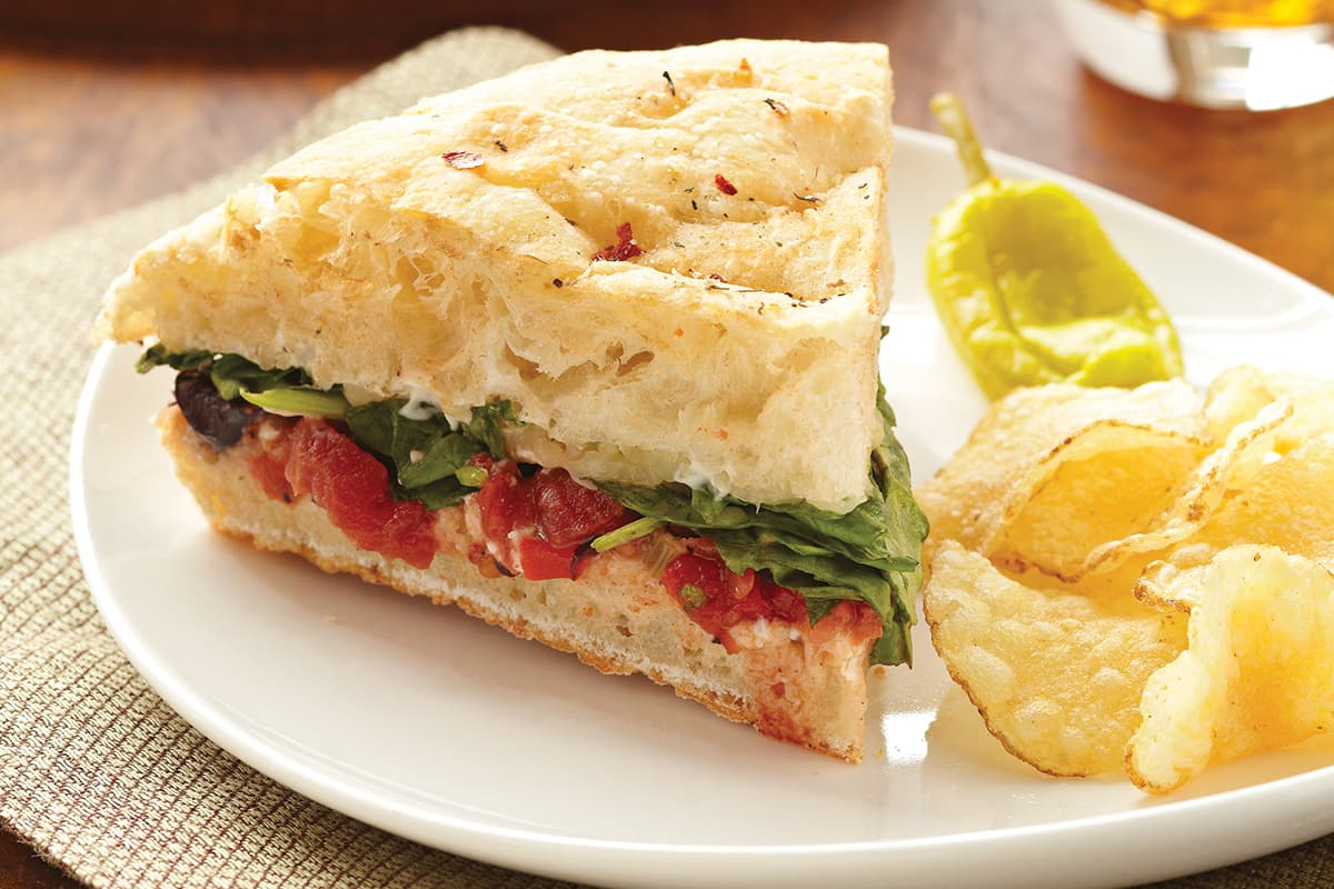 Stuffed Focaccia with Spinach, Tomatoes, Olives and Mozzarella